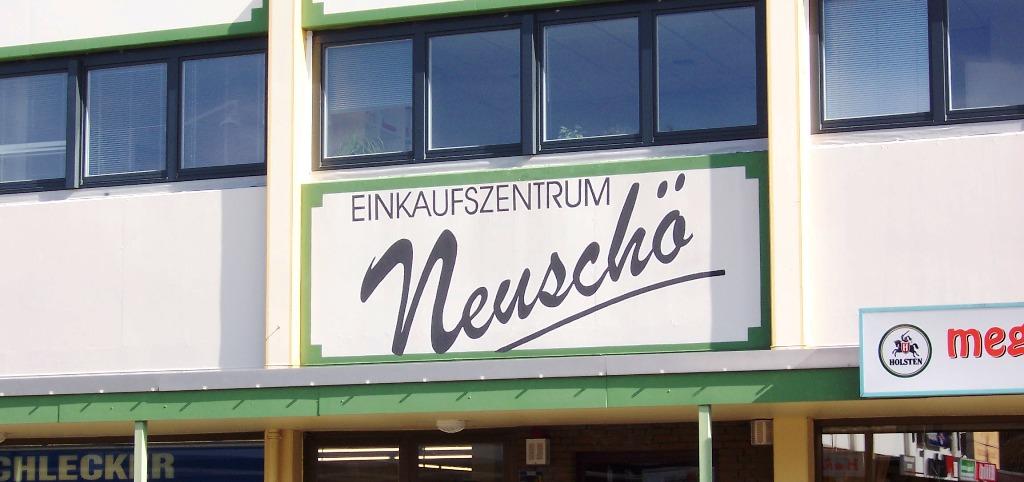 Logo des Einkaufszentrums Neuschönningstedt
